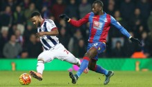 Crystal Palace's Yannick Bolasie, right, and West Bromwich Albion's Stephane Sessegnon battle for the ball during the English Premier League soccer match at The Hawthorns, West Bromwich, England, Saturday Feb. 27, 2016. (Tim Goode/PA via AP) UNITED KINGDOM OUT NO SALES NO ARCHIVE